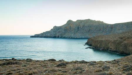 Trafoulas mountain near to Tripiti beach. Crete Greece. Beautiful landscape sea and mountains on sunset.