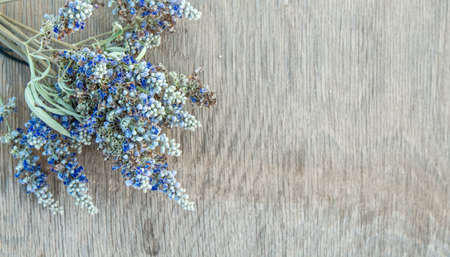 Beautiful Greek wild lavender on natural wooden background. Copy space for text. Aromatherapy and essential oil concept. Space for you product.