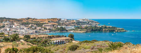 Agia Pelagia is a small town with a beautiful beach at Bay Aghia Pelaghia near Heraklion, Crete, Greece. Panoramic view HD Agia Pelagia. Travel and holidays places.