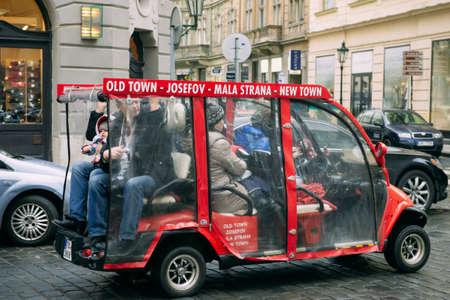 minibus: Red touristic electric minibus on Prague street