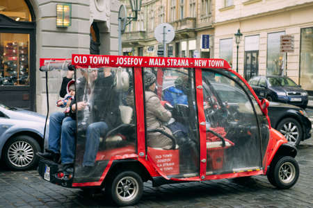 touristic: Red touristic electric minibus on Prague street