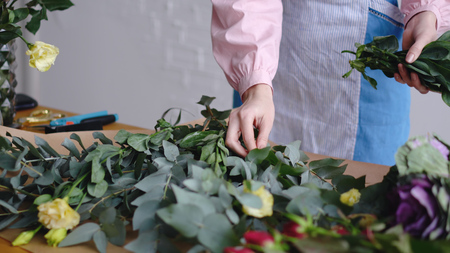 View of florist arranging different flowers