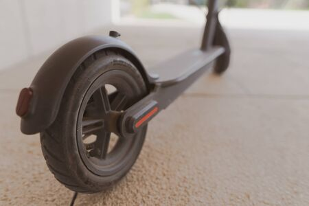 Close-up of the rear black wheel of an electric bike. Alternative transport, eco friendly Stockfoto