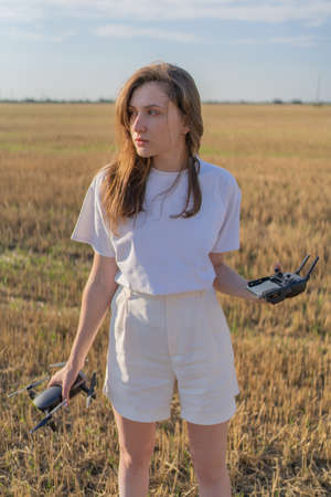 Drone pilot woman. Professional UAV operator in the agricultural field