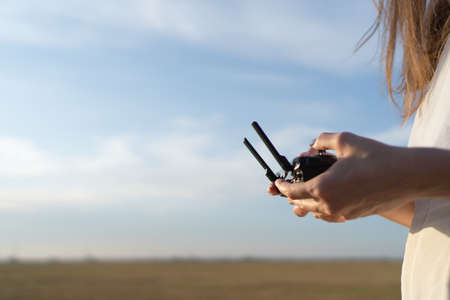 Drone controller in womens hands against a beautiful sky. Copyspace for your text Standard-Bild