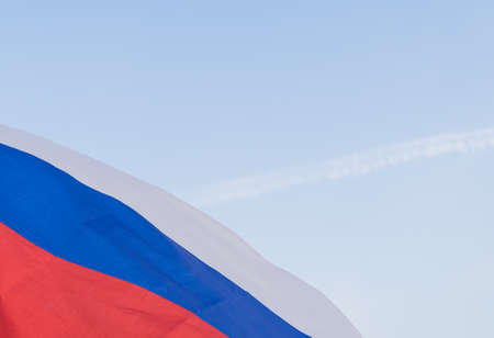 The national symbol - the flag of Russia waving in the wind against the sky. Day of the flag of the Russian Federation Standard-Bild