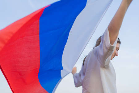 Russias Independence Day. Patriot with a national symbol in her hands