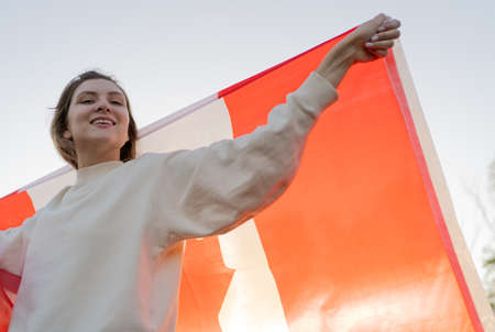 Portrait of excited woman with Canadian flag. Patriotic People of Canada