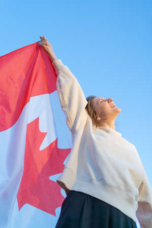 The happy Canadian celebrates and rejoices in success and victory.