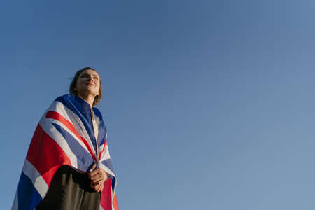 English patriotism. British woman with national symbol of her country