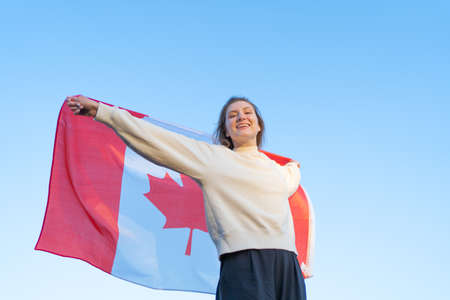 Canada Day. The national symbol of the country. Canadian flag waving in womans hands Standard-Bild