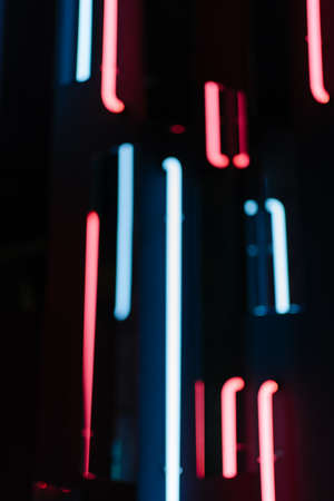Blurred neon lamps glow red and blue. Abstract light of photo zone defocused Foto de archivo