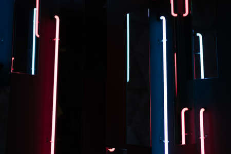 The geometric light of neon lamps. Futuristic static background Imagens
