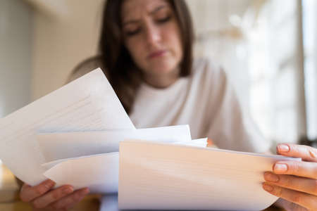 The manager cant handle the workload. A lot of documents and accounts in the womans hands close up Imagens