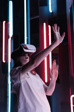 Immersive experience in cyberpunk and retrofuturism. Interacting with VR technology