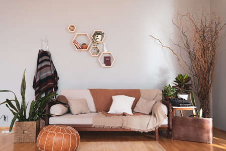 Cozy furniture and houseplants in a modern Scandinavian house. Hygge and Lagom concept