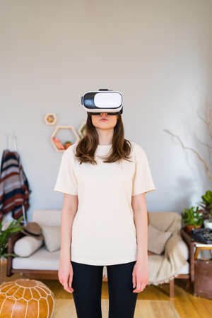 Woman in digital reality. VR Technology in cosy room Imagens