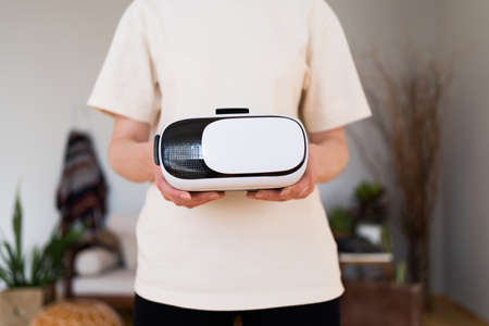 VR headset in womens hands close up. Virtual reality technology Imagens