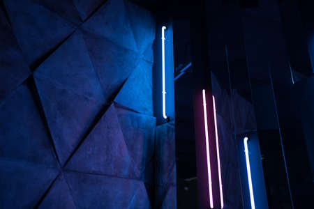 Neon lines and abstract interior design. Modern architecture in the house