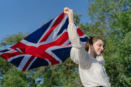 The national flag in the hands of a young patriot. Pride of country, United Kingdom