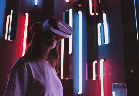 A woman in cyberspace. Virtual reality. Playing in a helmet
