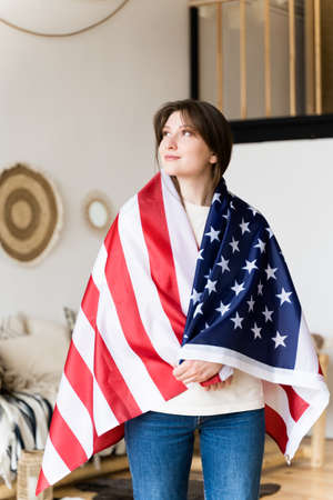 Patriot with the national flag of US. A symbol of American independence. Democracy, pride and freedom