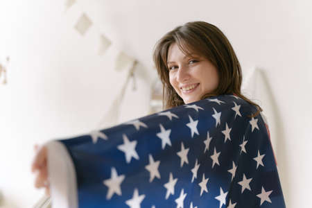 American flag. Democracy. A resident of the United States. Student with national symbol of the country Archivio Fotografico