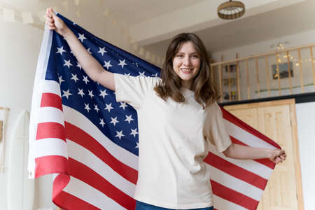 A resident of America celebrates a national holiday. The American flag. Democracy, freedom, independence