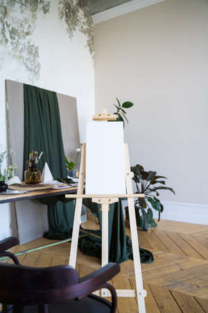 White canvas on an easel. Art. Empty picture