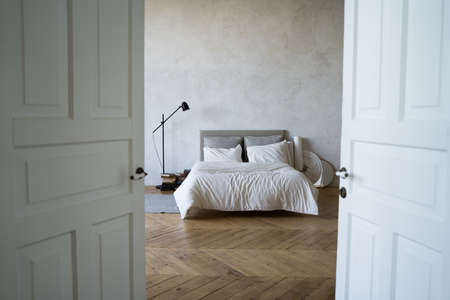 Bedroom with a bed. The interior of modern Scandinavian-style apartments Archivio Fotografico