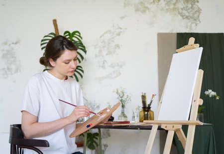 Creative hobby. Portrait of a female artist in an art studio