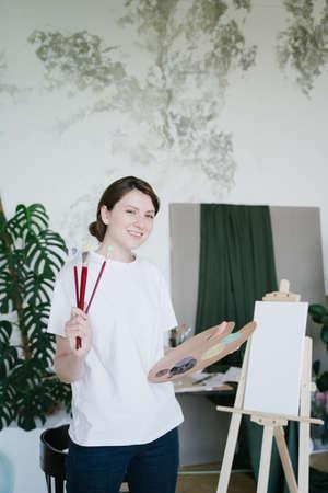Portrait of an artist. A talented successful woman. Inspiration artwork