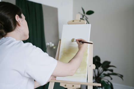 Creative occupation. The artist work with oil paints. Fine art on white canvas in the studio