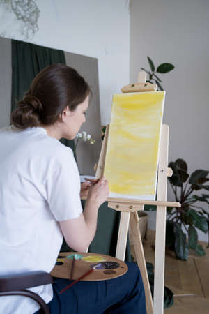 A creative young entrepreneur. Artist works in a creative workshop