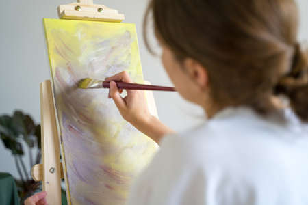 Contemporary art. Woman artist working on an abstract painting Archivio Fotografico