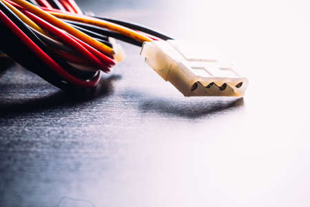 cable tangle: connector plug  of  computer power supply on dark background Stock Photo