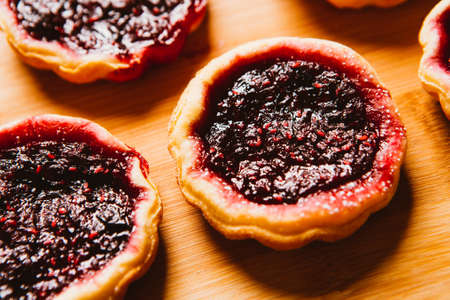 owning: close-up muffins with garden berries  on wooden background
