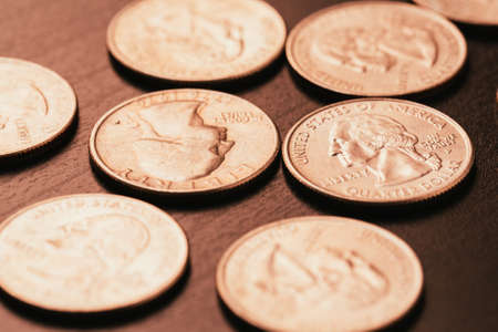 confined: American coins on wooden and blurred background Stock Photo