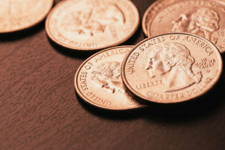 25 cents: American coins on wooden and blurred background Stock Photo