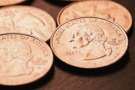 American coins on wooden and blurred background Stock Photo