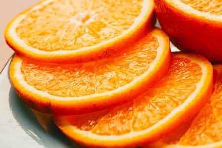 sliced orange: Fresh sliced orange slices close-up on plate Stock Photo