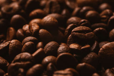 Attar: Roasted coffee beans, can be used  as a background.  Coffee beans texture macro Stock Photo