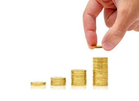 Successful investment. Conceptual business picture. Columns of gold coins and businessmans hand isolated on white background with reflection photo
