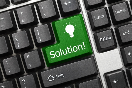 Close up view on conceptual keyboard - Solution  green key  Stock Photo - 14698911