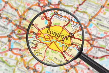 Tourist conceptual image  Destination - London  with magnifying glass  photo