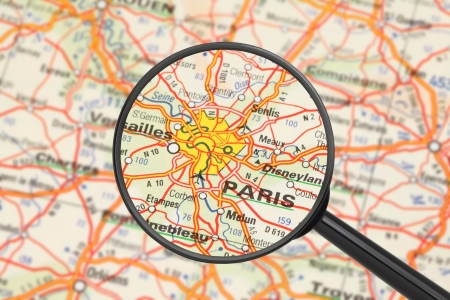 Tourist conceptual image  Destination - Paris  with magnifying glass  Stock Photo - 14698945