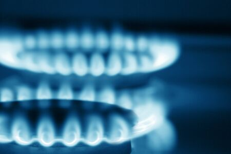 Close up view on two burners of cooker  blue toned  photo