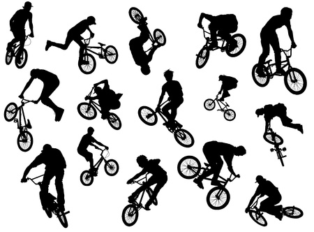 Black silhouettes of BMX-riders photo