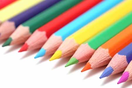 Line of colored pencils isolated on white background photo