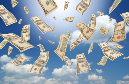 Falling dollars  sunny sky background  Stock Photo